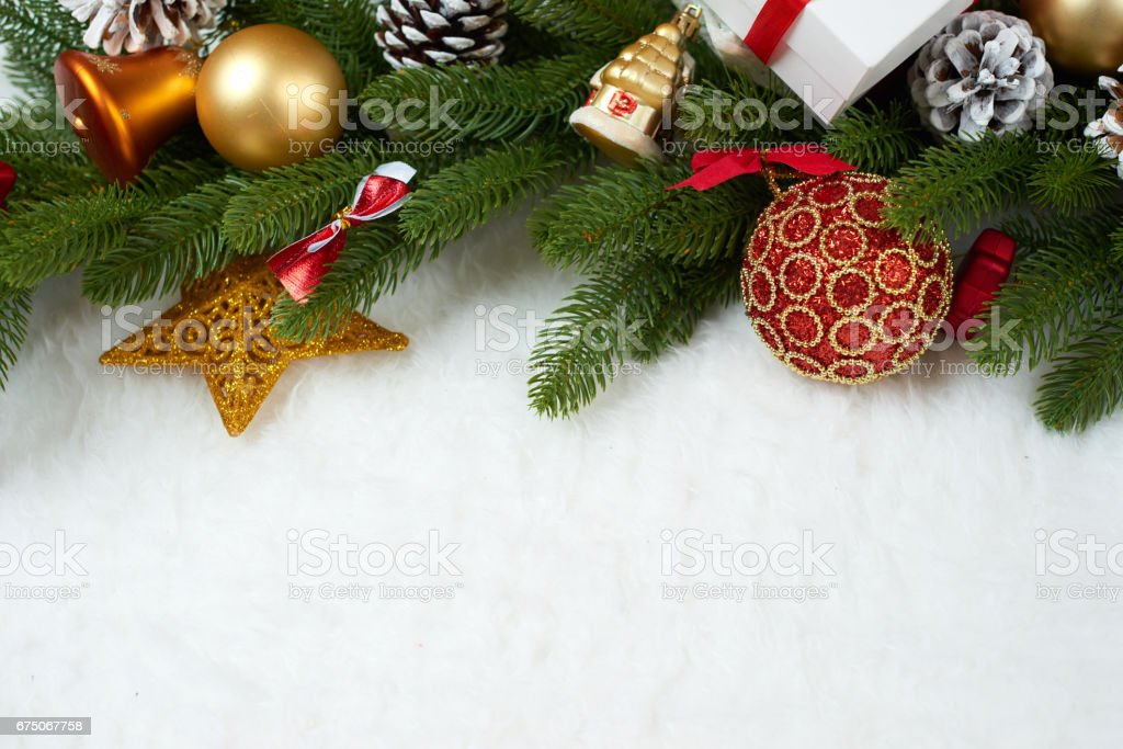 christmas decoration on fir tree branch closeup, gifts, xmas ball, cone and other object on white blank space fur, holiday concept, place for text stock photo