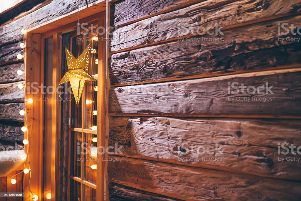 Christmas decoration on wooden cabin stock photo