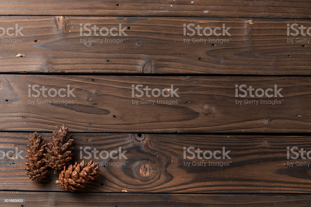 Christmas decoration: pine flowers cone on rustic brown wooden background stock photo