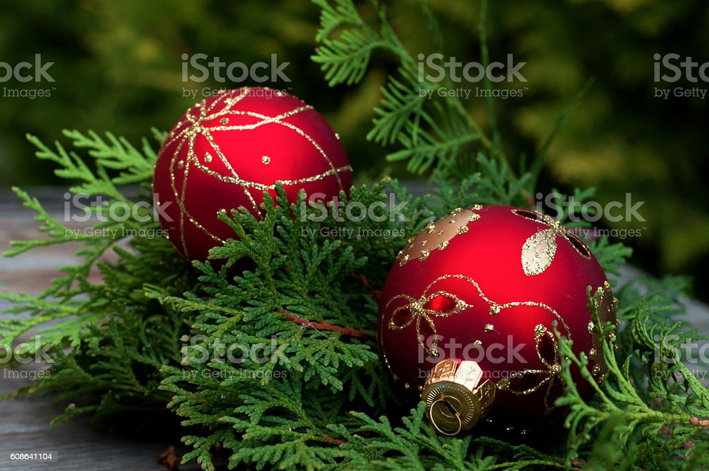 Christmas decoration. Red balls on wooden table stock photo