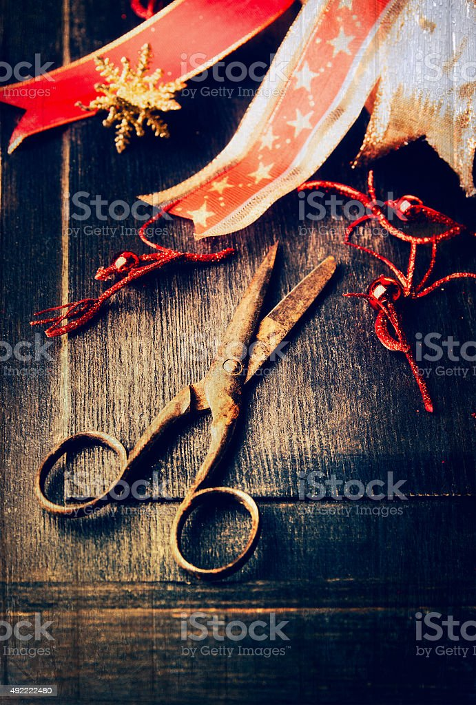 Christmas decoration with aged scissors on dark wooden background stock photo