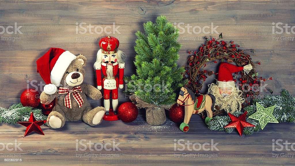 christmas decoration with antique toys teddy bear and nutcracker stock photo
