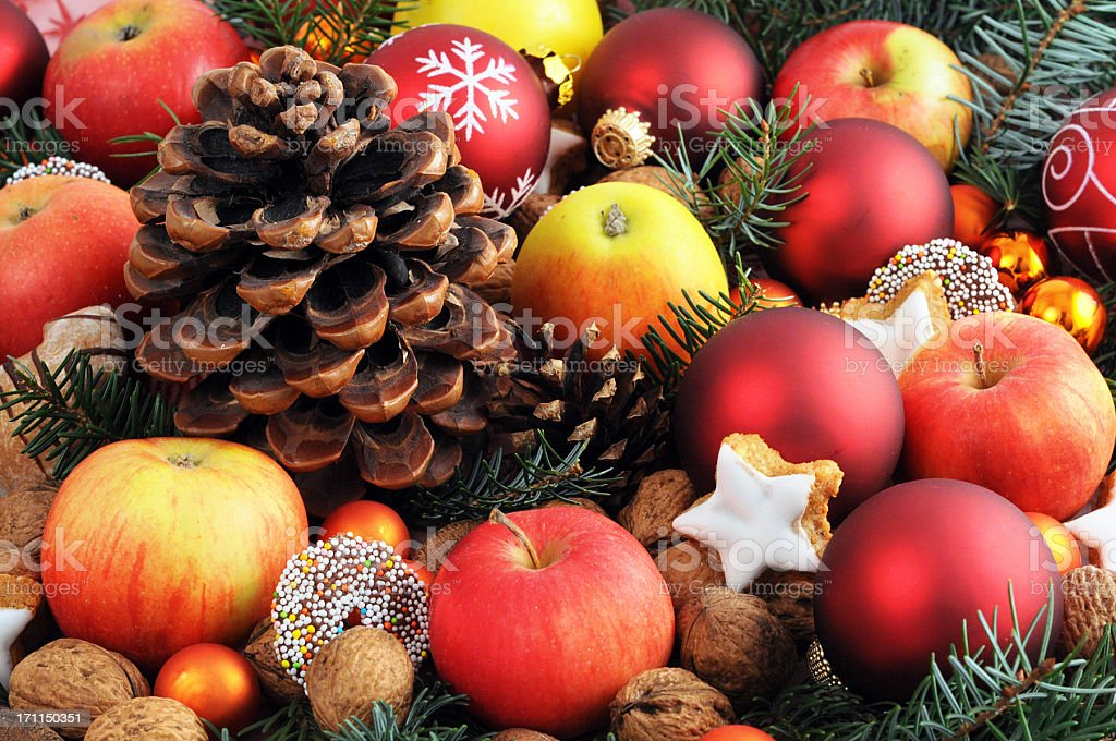 Christmas decoration with baubles apples nutes and cookies stock photo