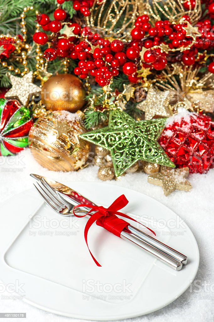 Christmas decoration with baubles golden garlands red berries stock photo