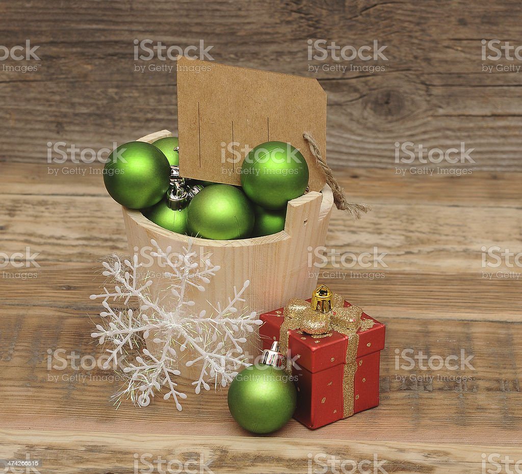 Christmas decoration with blank price tag on wooden plank royalty-free stock photo