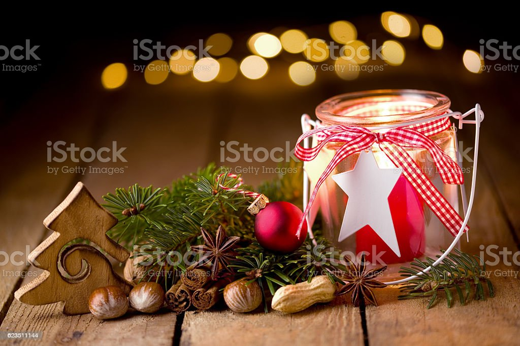 Christmas decoration with candle and lights stock photo