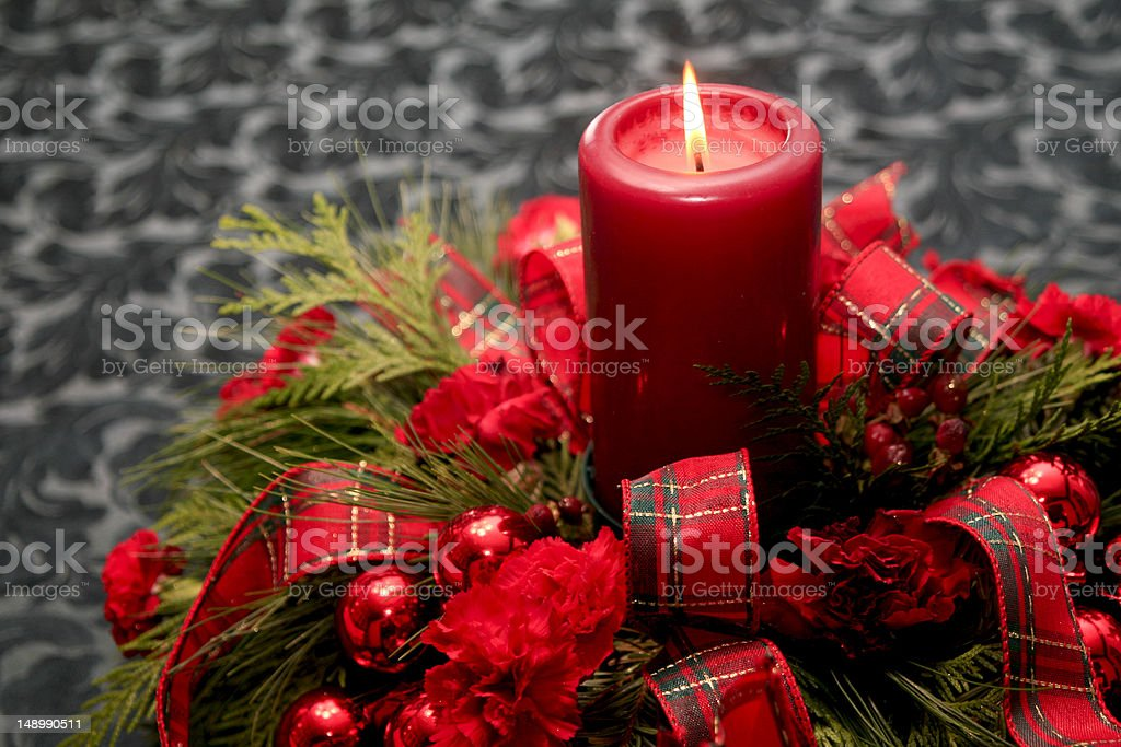 Christmas decoration with candle and red ribbon stock photo