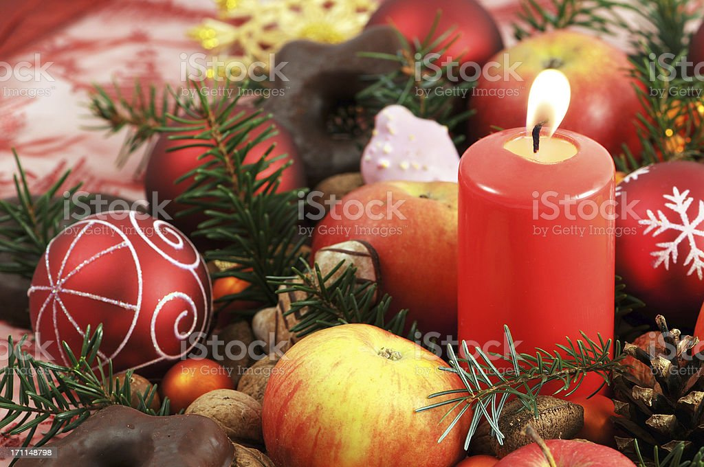 Christmas decoration with candle baubles apples nutes cookies royalty-free stock photo