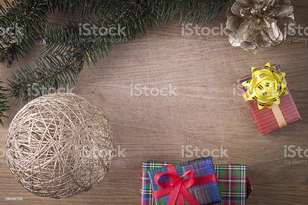 Christmas decoration with gifts on old wood royalty-free stock photo