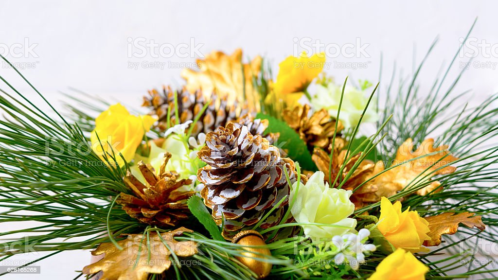 Christmas decoration with golden pine cones and fir branches stock photo