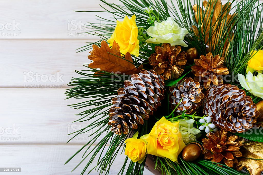 Christmas decoration with golden pine cones on white background stock photo