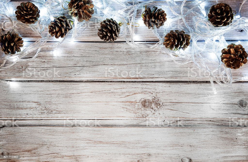 Christmas decoration with lights and pine cone stock photo