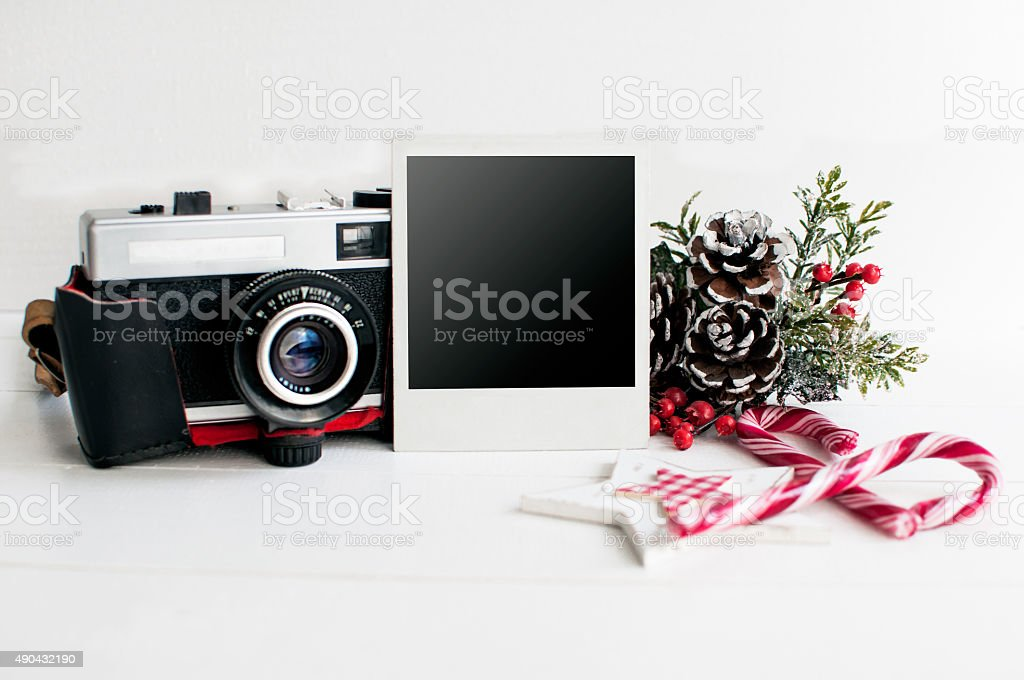Christmas decoration with old camera and picture frame, vintage stock photo