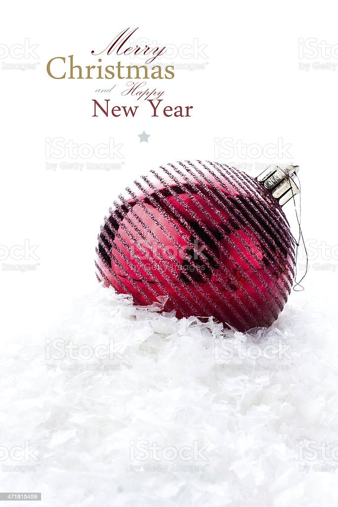 Christmas decoration with red bauble and snow royalty-free stock photo