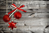 Christmas decorations and a red ribbon bow on wood