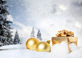 Christmas decorations and gift box in snow