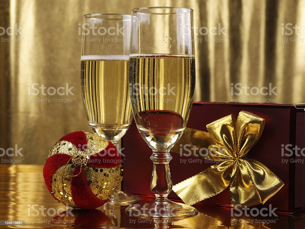 Christmas decorations and  glasses with champagne stock photo