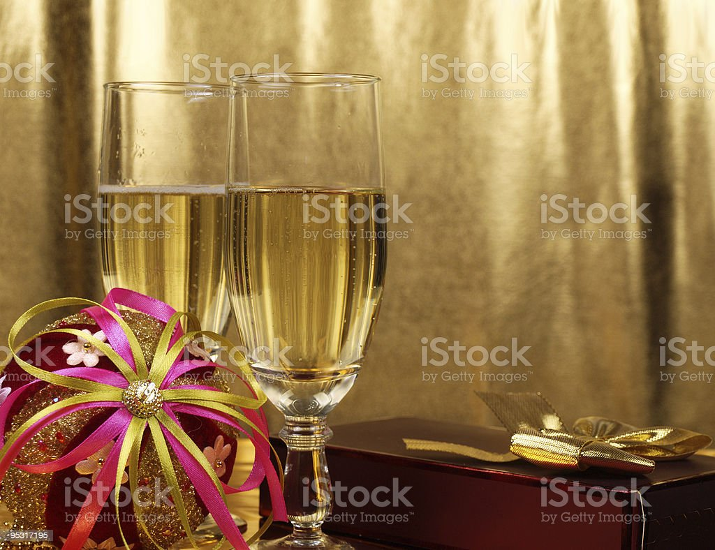 Christmas decorations and glasses with champagne royalty-free stock photo