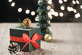 christmas decorations and green present on wood