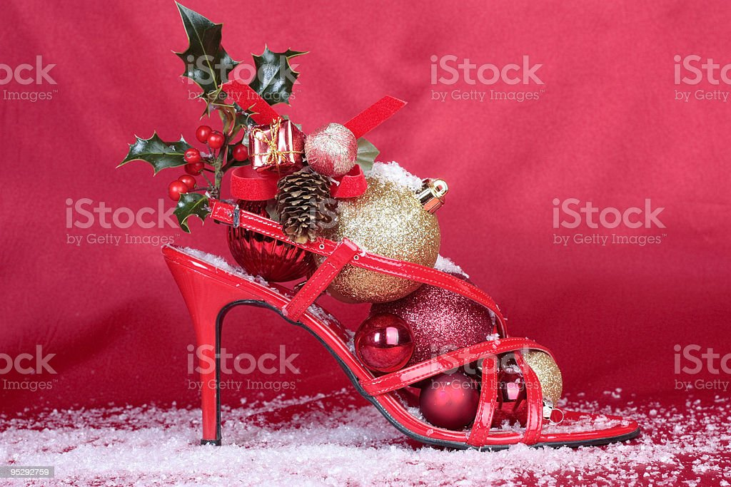 Christmas decorations and ladies shoe stock photo