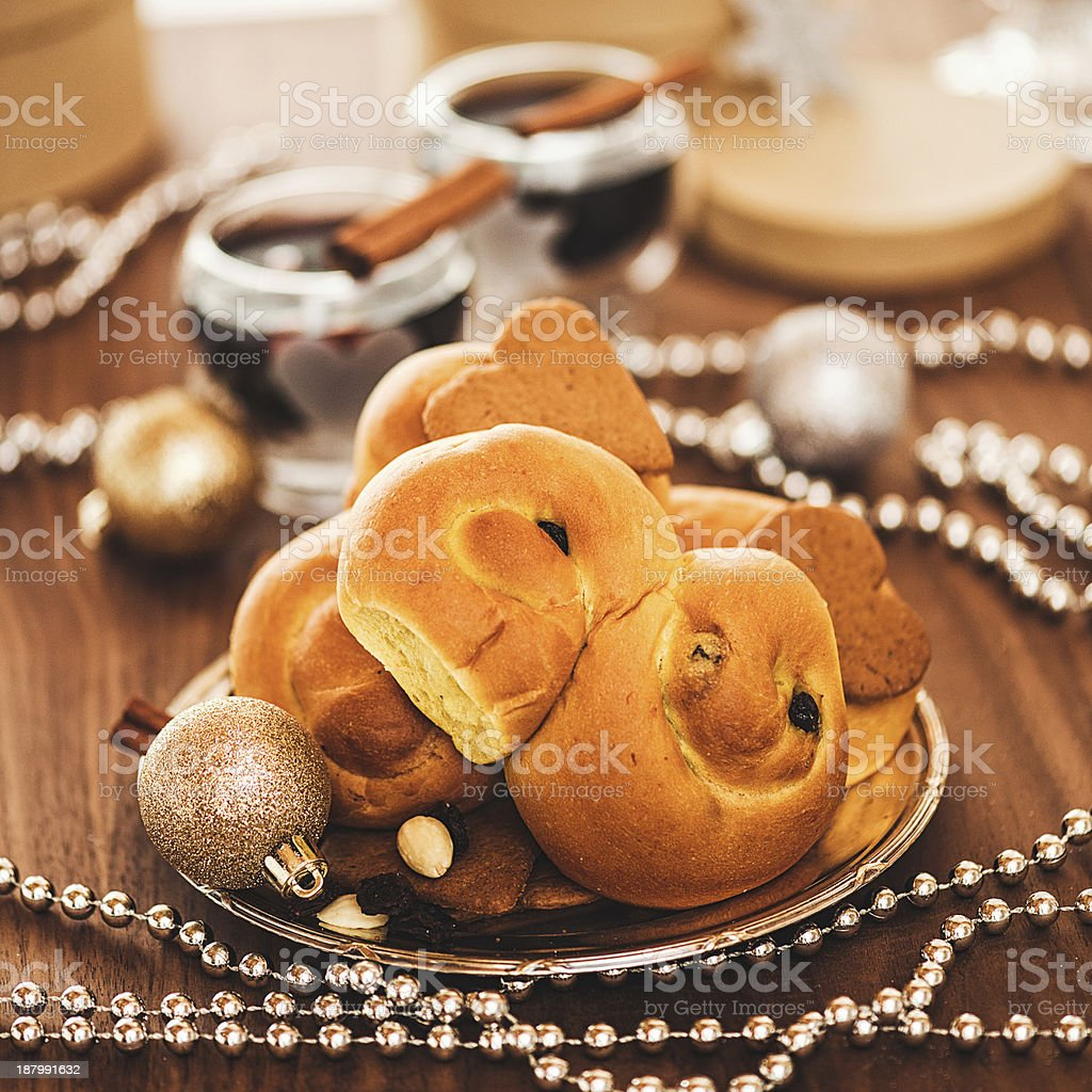 Christmas decorations and saffron buns royalty-free stock photo