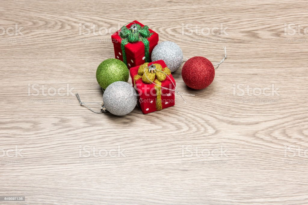 Christmas decorations are on the wooden table. stock photo