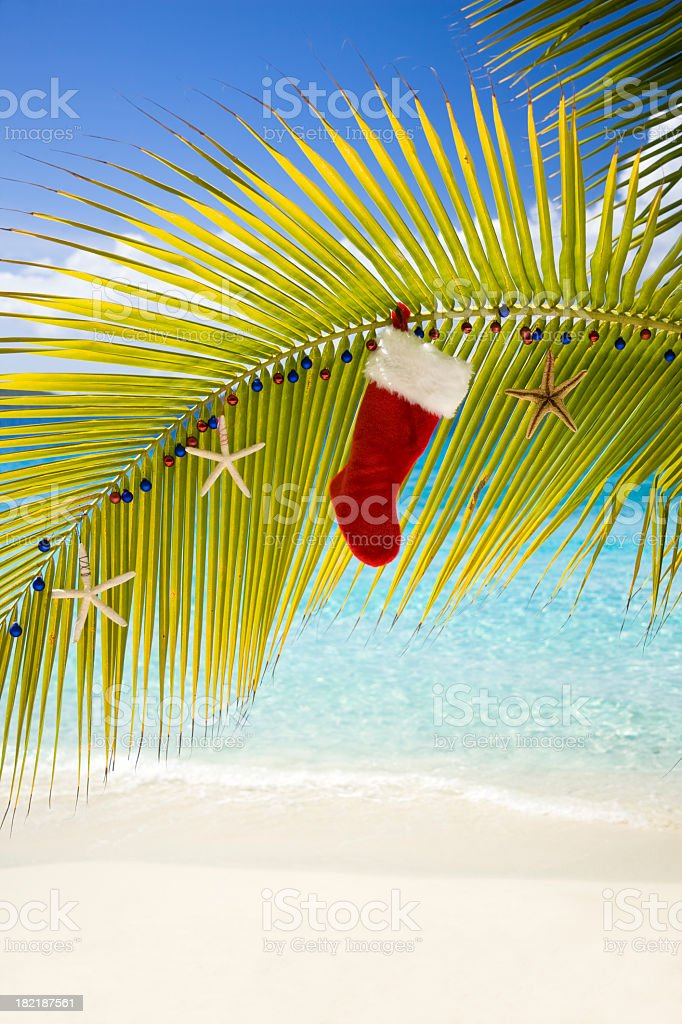 Christmas decorations at a tropical beach royalty-free stock photo