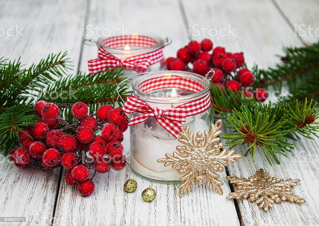 christmas decorations candles in glass jars with fir stock photo