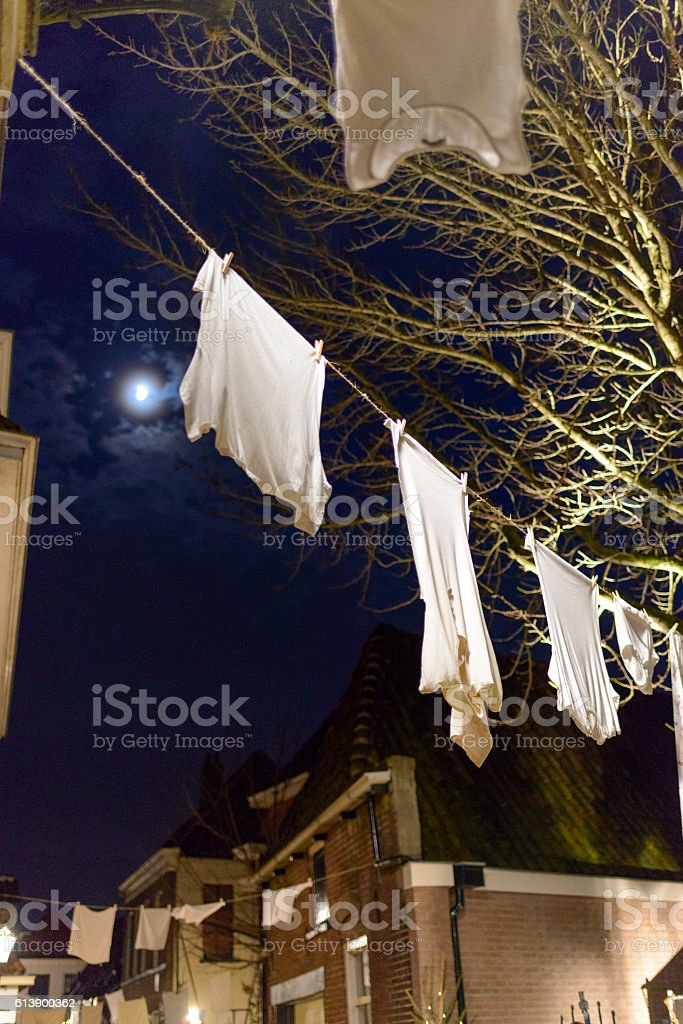 Christmas decorations in a shopping street in the evening stock photo