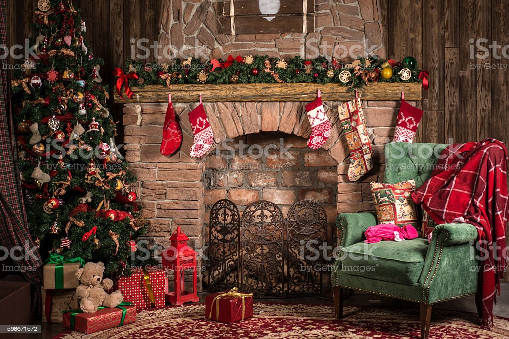 Christmas decorations of the room: fireplace, chair, tree stock photo