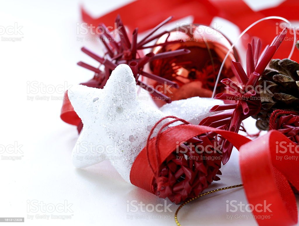 Christmas decorations (star, balls, cones) on a white background royalty-free stock photo
