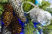 Christmas decorations on artificial fir.