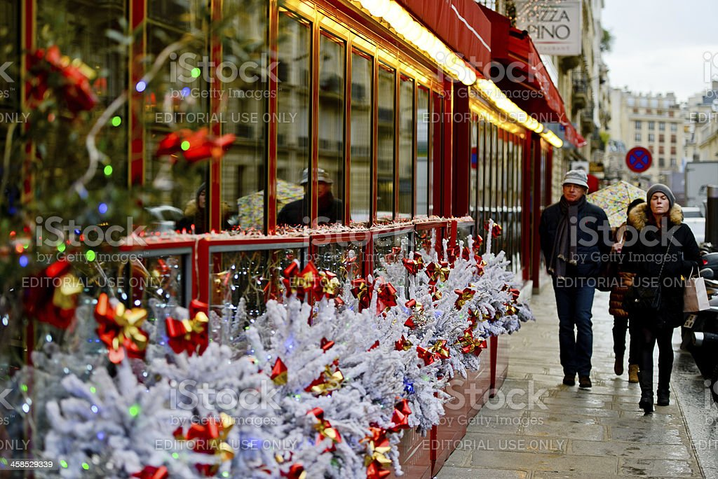 Christmas decorations on Pizza Pino Restaurant, Paris stock photo