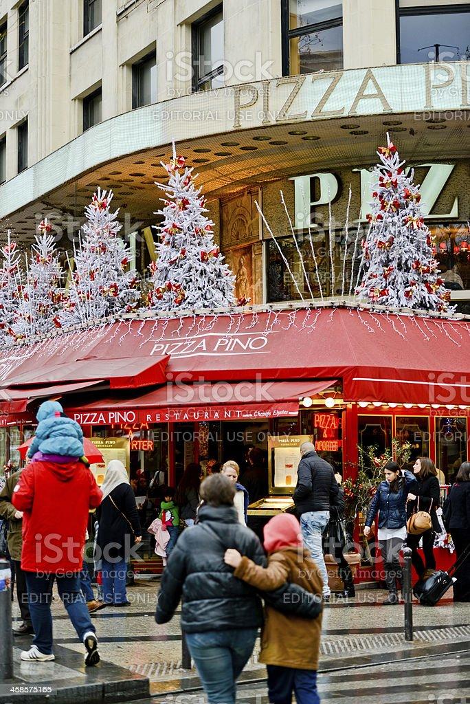 Christmas decorations on Pizza Pino Restaurant, Paris royalty-free stock photo
