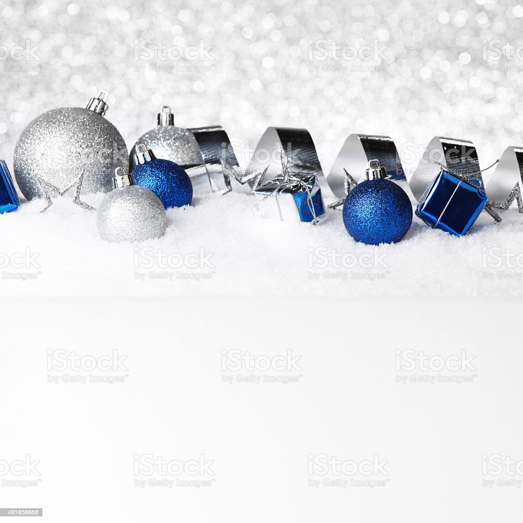 Christmas decorations on snow stock photo
