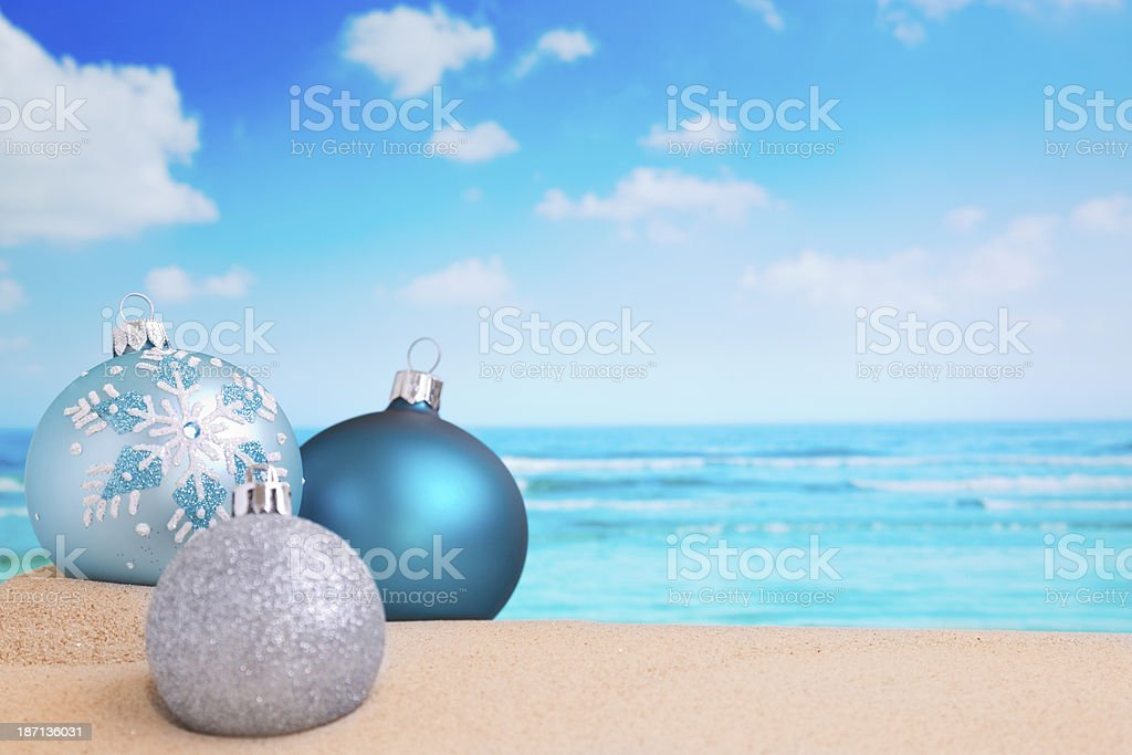 Christmas decorations on the beach, ocean in the back royalty-free stock photo