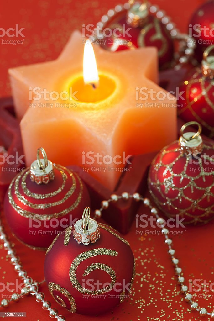 Christmas Decorations with Baubles & Burning Candle royalty-free stock photo
