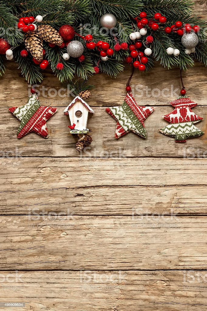 christmas decorations with ornaments on wooden background stock photo