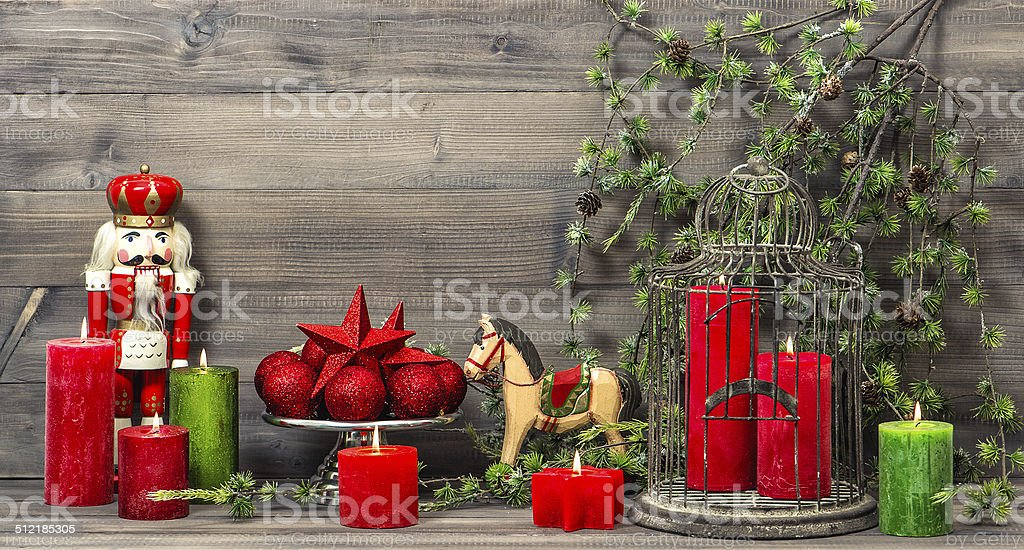 christmas decorations with red candles and vintage toys stock photo