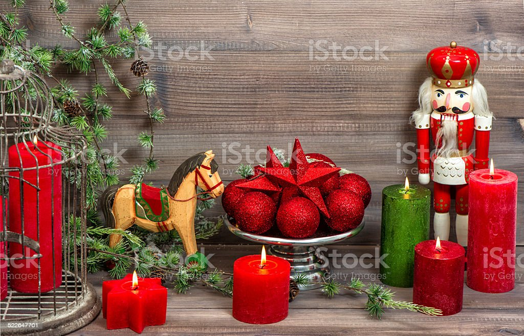 christmas decorations with red candles, baubles, antique toys stock photo