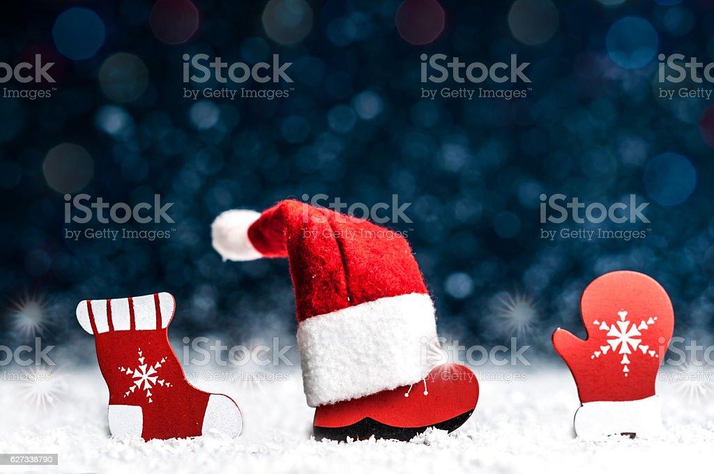 Christmas decorative ornaments on a snowy dark blue background stock photo