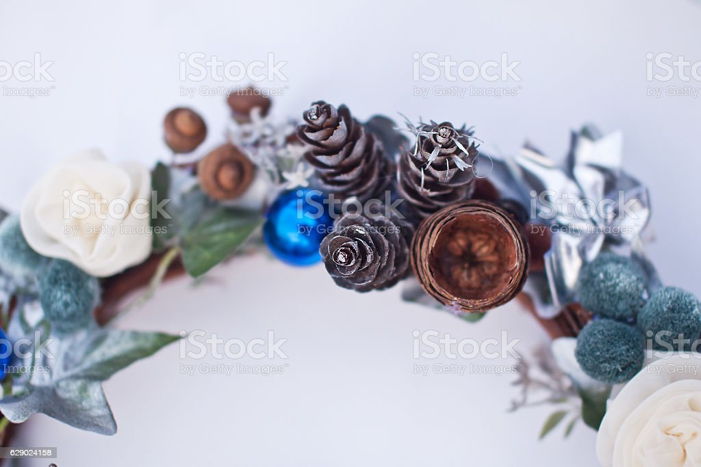 Christmas decorative wreath of cone, artificial flowers and fir-tree balls. stock photo