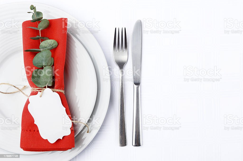Christmas dinner cutlery with white plates royalty-free stock photo