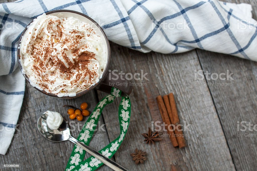 Christmas drink with whipped cream, decorated with a ribbon stock photo