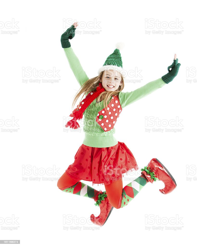 Christmas Elf Jumps in the Air stock photo