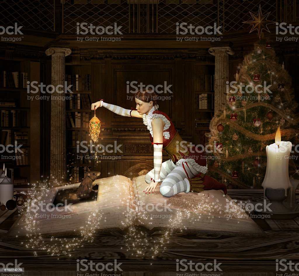 Christmas elf sits on a book with lantern and mouse stock photo