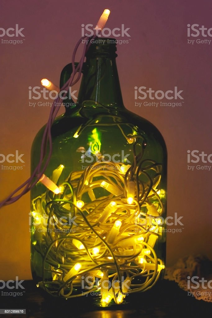 Christmas enchanting lights in a glass jar of green color, glowi stock photo