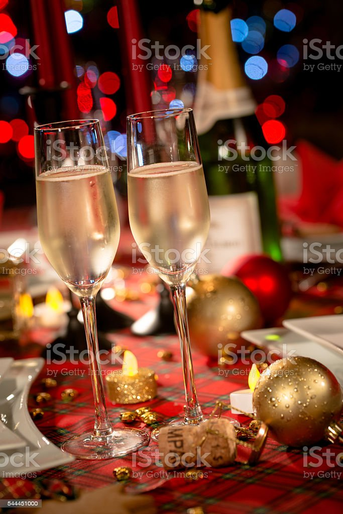 christmas eve party table champagne flute red and golden glitter stock photo