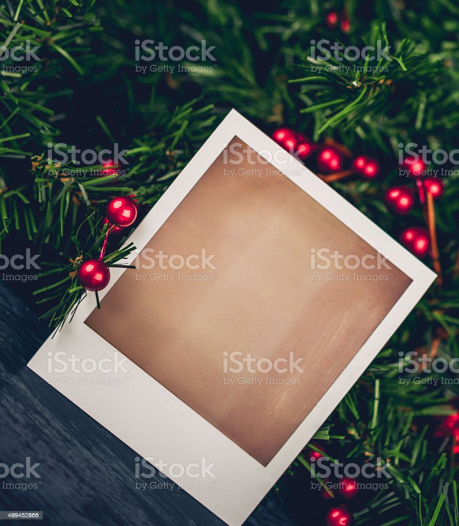 Christmas evergreen garland with blank photo frame for Christmas Card stock photo