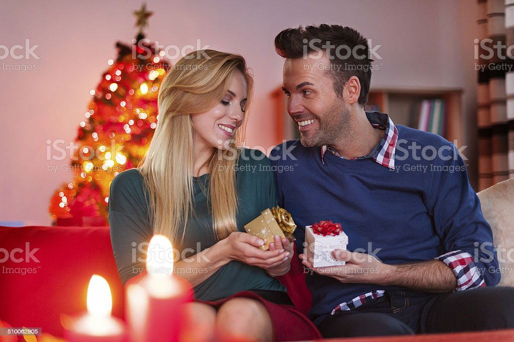 Christmas exchanging gifts of loving couple stock photo
